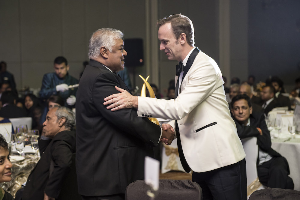 Pradeep Moraes, the first-ever Sri Lanka Real Estate Personality of the Year winner, is being congratulated by Asia Property Awards founder and managing director Terry Blackburn