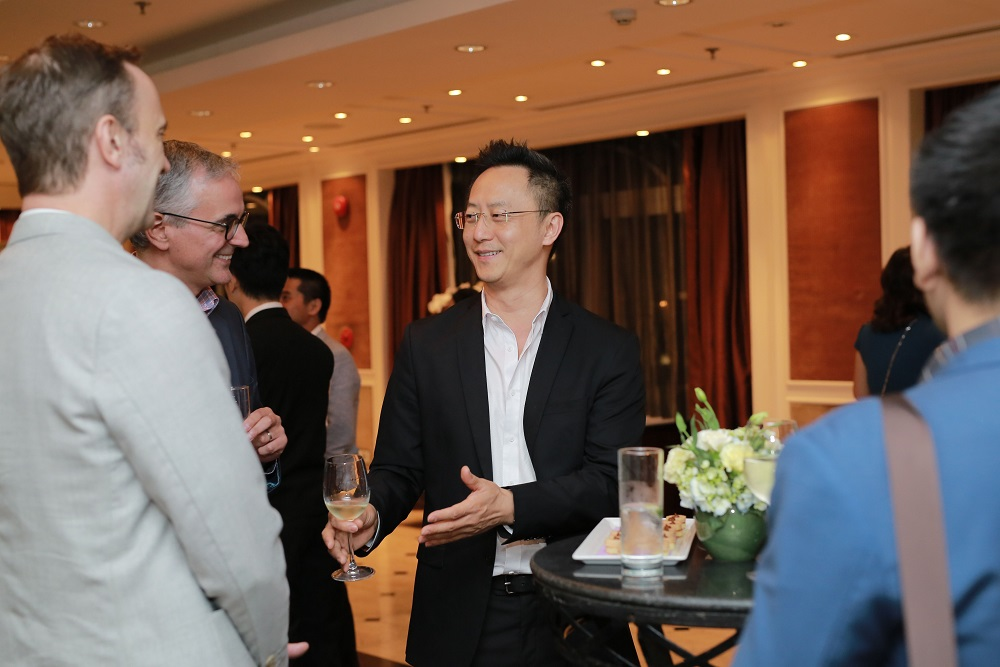 Thien Duong shares a laugh with Jeremy Lewis, COO of PropertyGuru Group, and Terry Blackburn