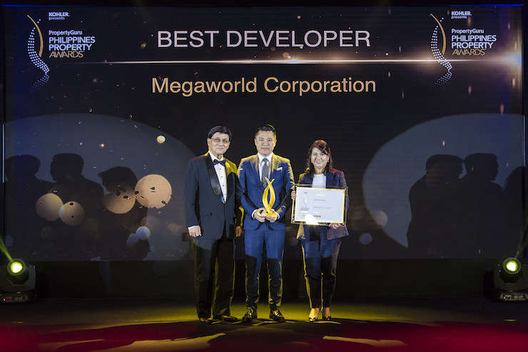 Independent judging panel chairman Dr Jaime A. Cura, PhD presents the Best Developer gong to Megaworld Corporation's SVP Kevin Tan and COO Lourdes T. Gutierrez-Alfonso