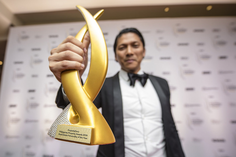 Robbie Antonio, founder and CEO of Revolution Precrafted – one of Southeast Asia's fastest startups to achieve unicorn status – shows off his 2018 Philippines Real Estate Personality of the Year statuette