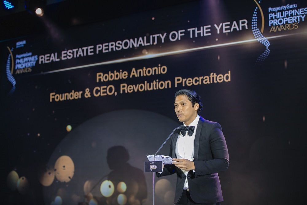 Revolution Precrafted's Robbie Antonio accepting the award for Real Estate Personality of the Year at the 2018 PropertyGuru Philippines Property Awards
