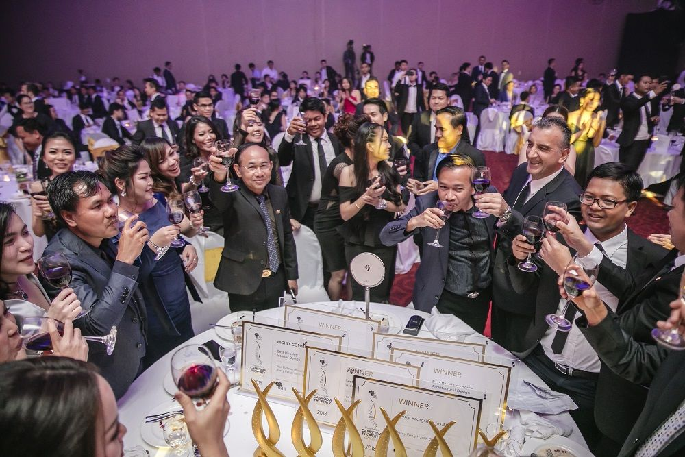 Attendees of the 2018 PropertyGuru Cambodia Property Awards raise a toast during the televised gala dinner