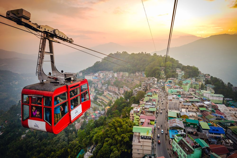 Tourists enjoy a cable car ride over Gangtok city in Sikkim, India. Vivek BR/Shutterstock