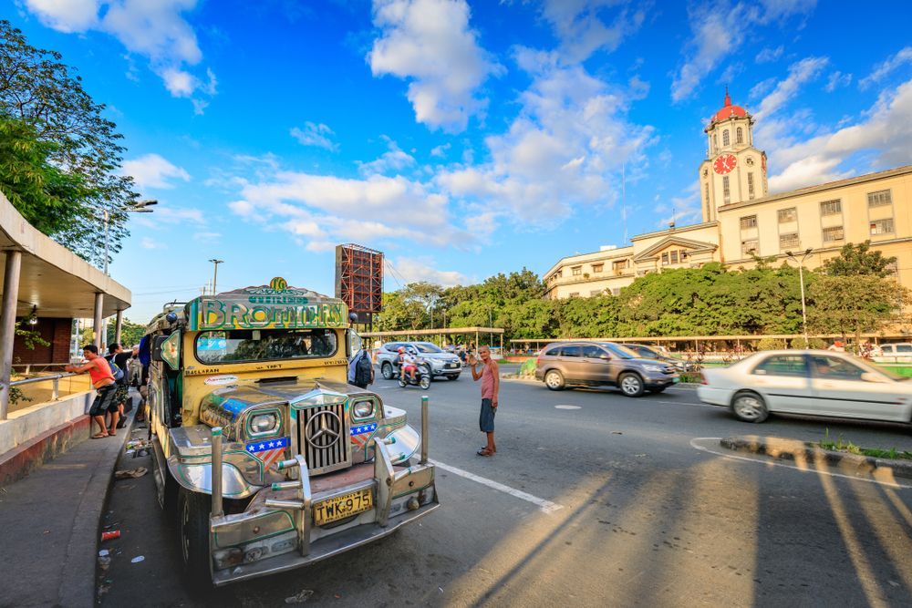 A 'jeepney' parked outside Manila City Hall. ArtyOoran/Shutterstock