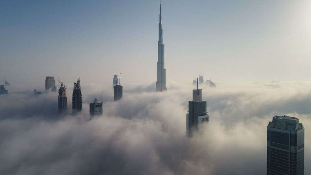 Aerial view of skyscrapers in Dubai, including the Burj Khalifa, currently the world's tallest human-made structure. Amazing Aerial/Shutterstock