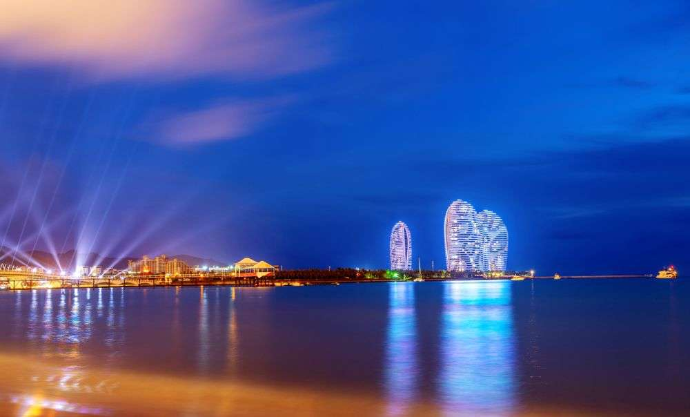 The gleaming towers of the Phoenix Island project facing Sanya Bay in Hainan, China. gyn9037/Shutterstock