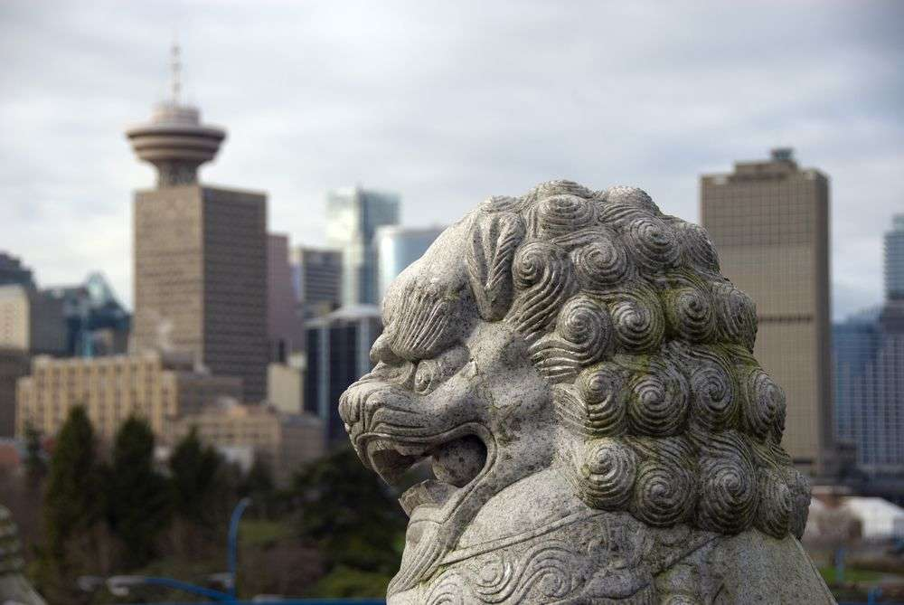 A Chinese lion statue in Vancouver, British Columbia. fotocraft/Shutterstock