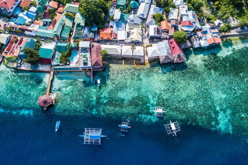 Aerial view of Oslob, a town snorkeling and scuba diving destination in Cebu, Philippines. Ghing/Shutterstock