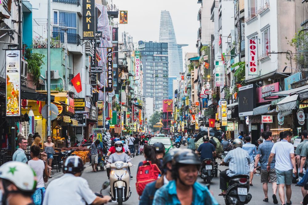 Colorful perspective of Bui Vien Street in Ho Chi Minh City with a view of Bitexco Financial Tower. David Bokuchava/Shutterstock
