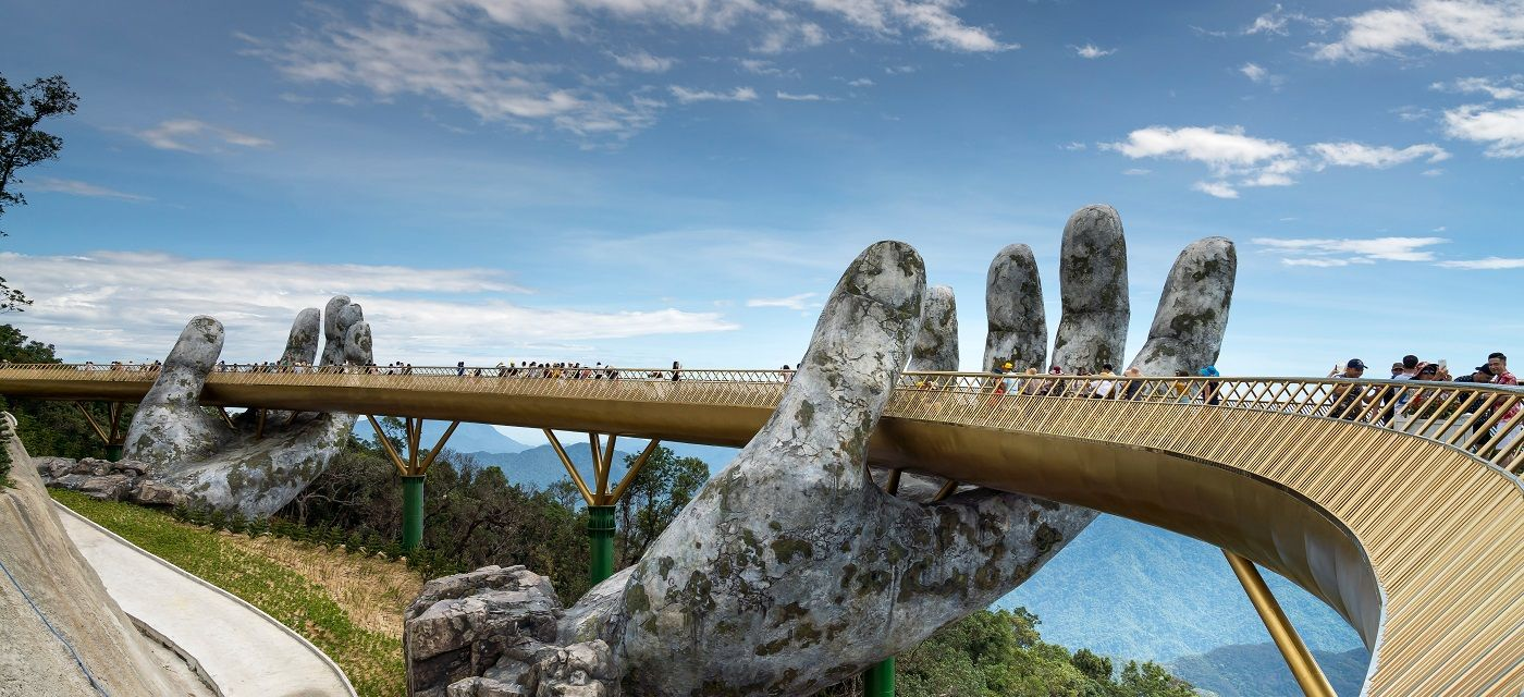 The Golden Bridge is lifted by two giant hands in the tourist resort on Ba Na Hill in Danang, Vietnam. Quang nguyen vinh/Shutterstock