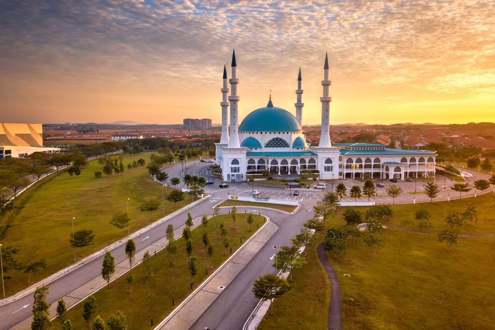 The Masjid Sultan Iskandar dominating the skyline of Johor Bahru, Malaysia during sunrise. Ijam Hairi/Shutterstock