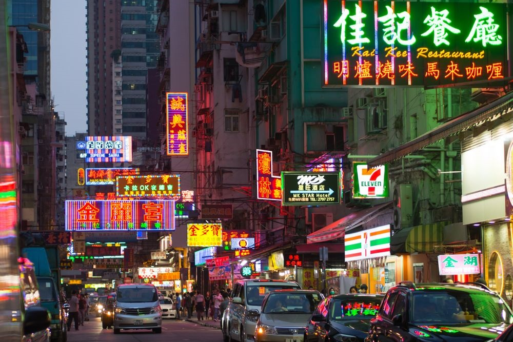 Neon pawn shop and restaurant signs in Mongkok, Hong Kong. shawn michael/Shutterstock