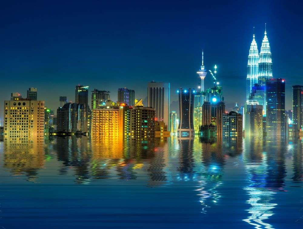 Kuala Lumpur's iconic skyline as reflected on pool. szefei/Shutterstock
