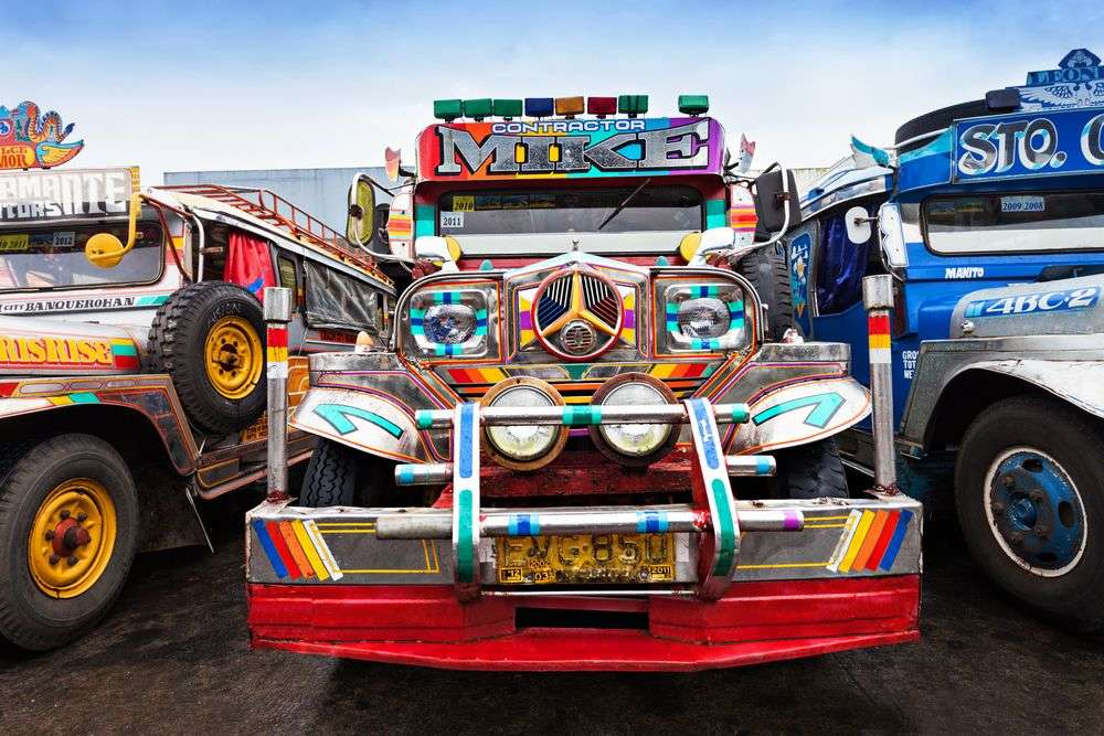 Jeepneys parked in a bus station in Manila, Philippines. saiko3p/Shutterstock