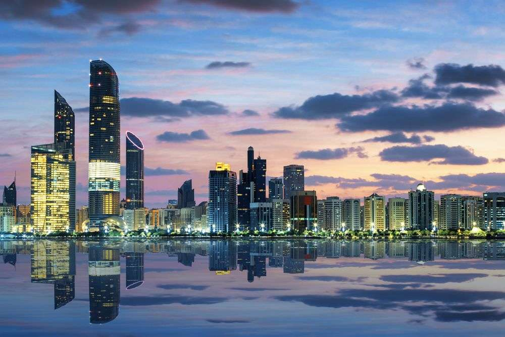 View of the Abu Dhabi skyline at sunset. prochasson frederic/Shutterstock
