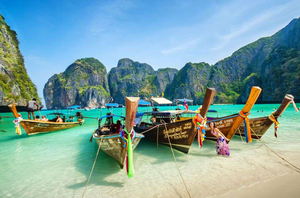 Long-tail boats along Phuket in Thailand. martinho/Shutterstock