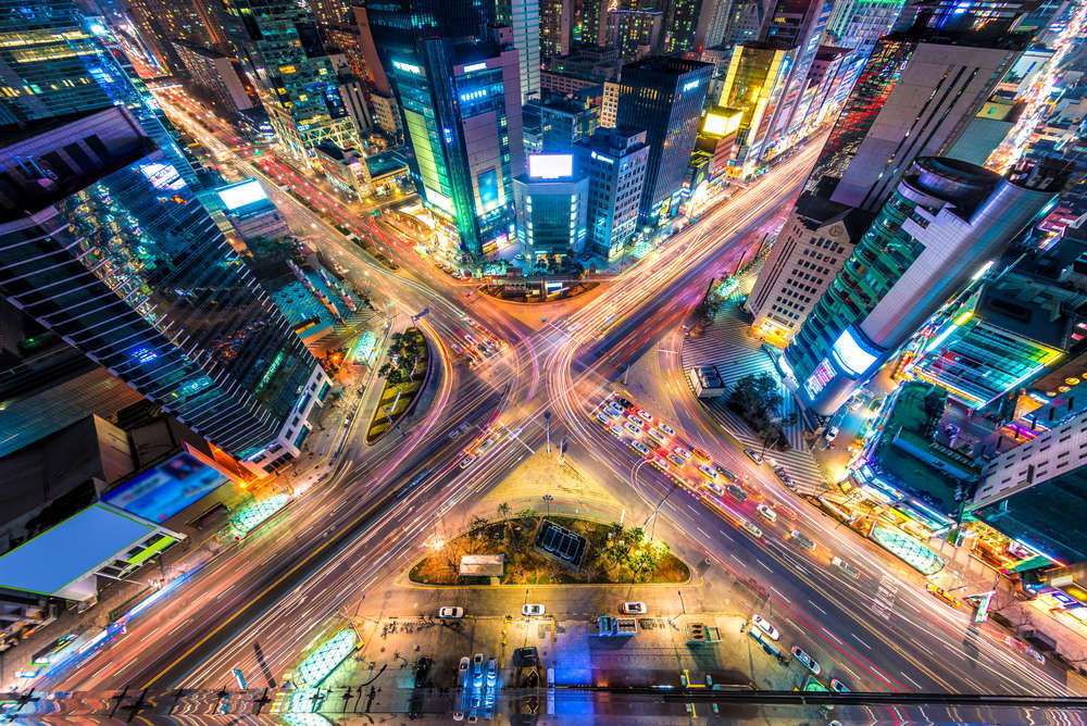 Looking down on a major intersection at night in Seoul, South Korea. Vincent St. Thomas/Shutterstock