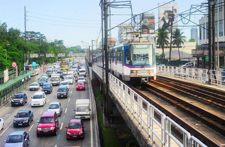 An LRT train approaches in Manila. joyfull/Shutterstock