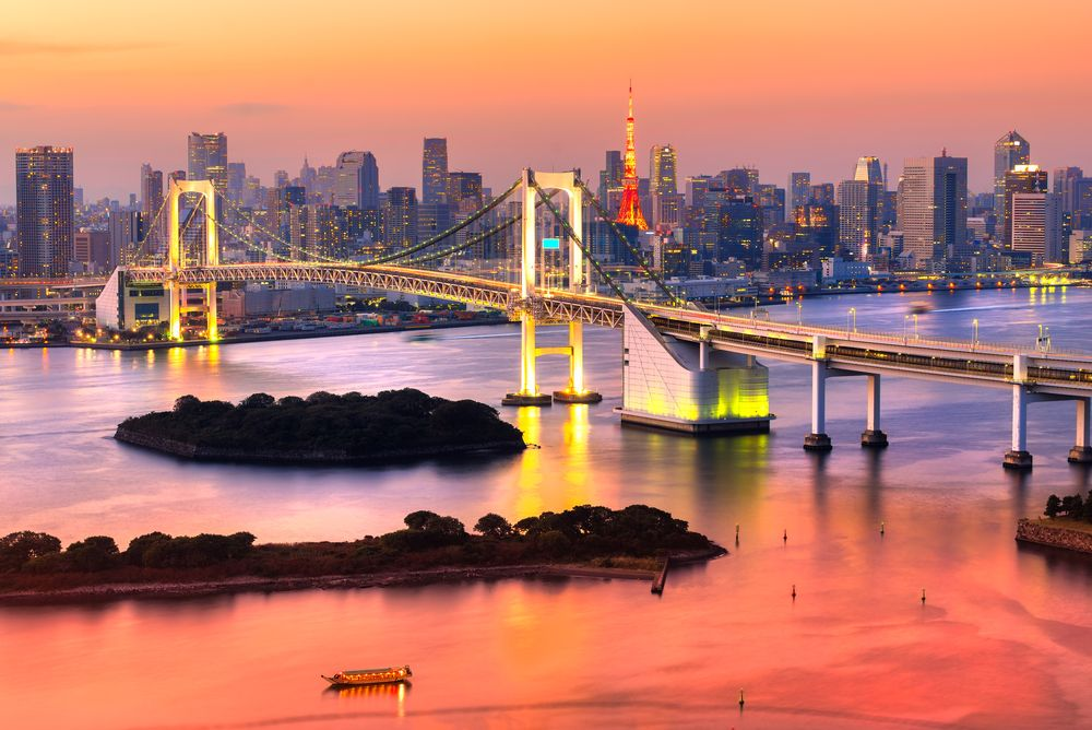 The Tokyo Tower and Rainbow Bridge in Tokyo, Japan. Luciano Mortula - LGM/Shutterstock
