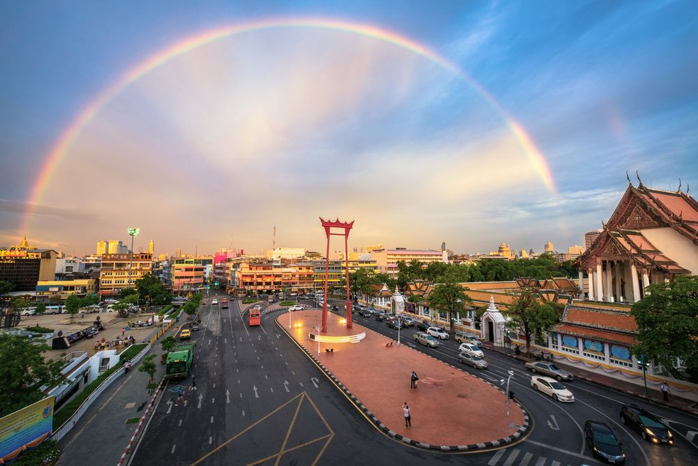 Rainbow over Sao Ching Cha (Giant Swing) and Wat Suthat in Bangkok, Thailand. Natapat2521/Shutterstock