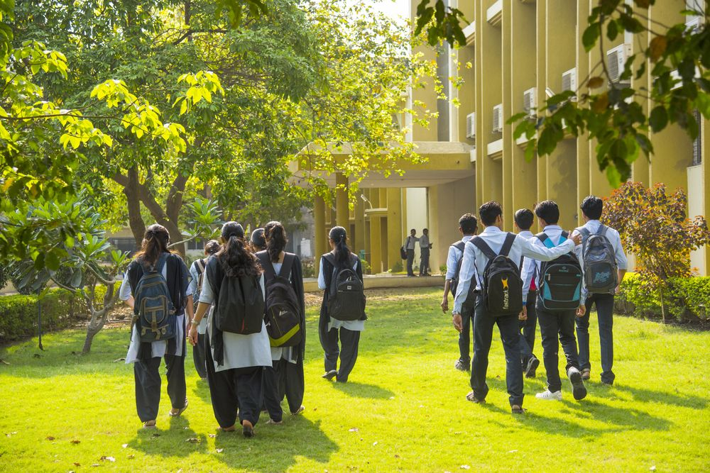 Students walk through the campus of a university in Nagpur, India. CRS Photo/Shutterstock