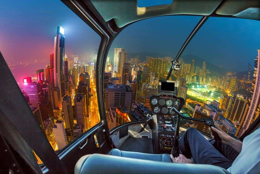 Fisheye view of Wan Chai district in Hong Kong island from helicopter cockpit. Benny Marty/Shutterstock
