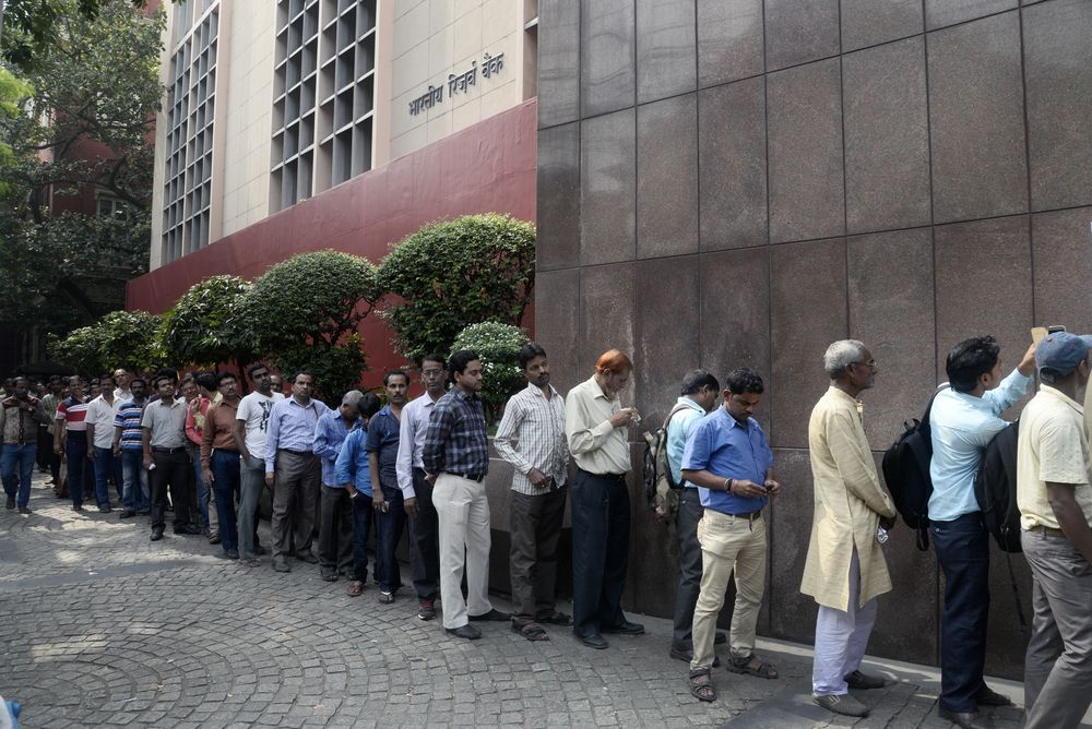 Long queue at the Reserve Bank of India in Calcutta to deposit old currency notes after the demonetisation drive in 2016. Saikat Paul/Shutterstock