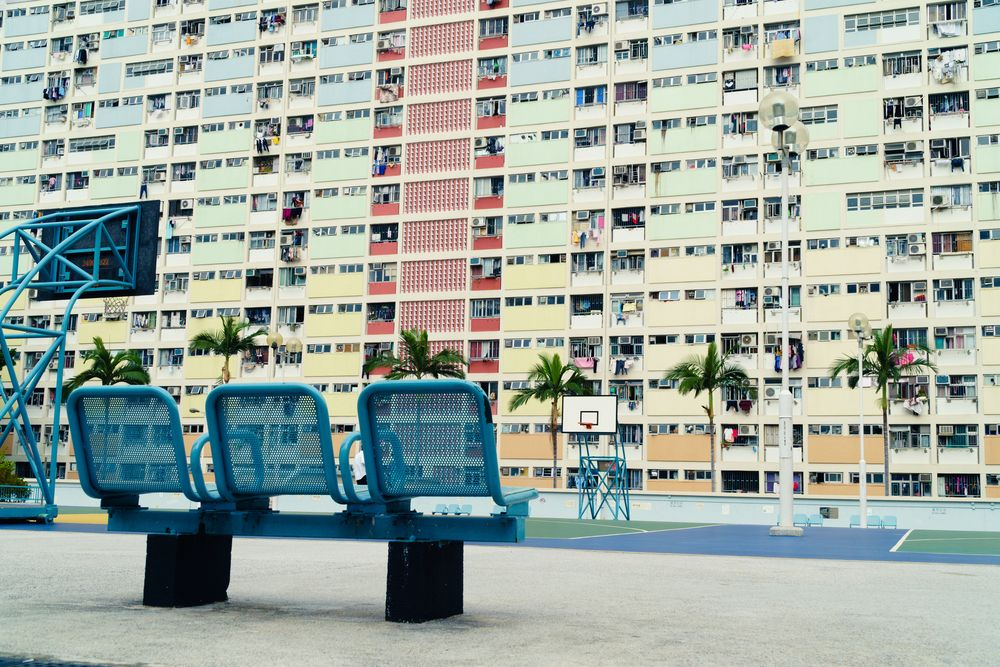 Flats above a basketball court in Hong Kong. WJRVisuals/Shutterstock