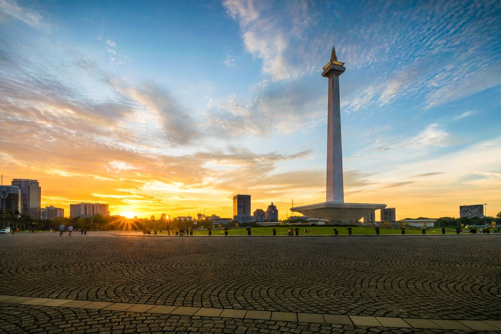 Sunset over National Monument in Jakarta. Jenvendes/Shutterstock