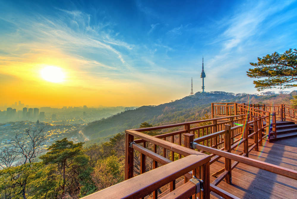 Sunset over Seoul as seen from Namsan park. TRAVAL TAKE PHOTOS/Shutterstock