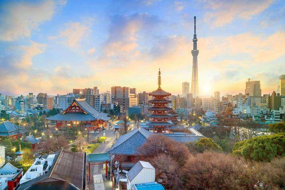 The skyline of Tokyo with Senso-ji Temple and the Skytree at twilight. f11photo/Shutterstock