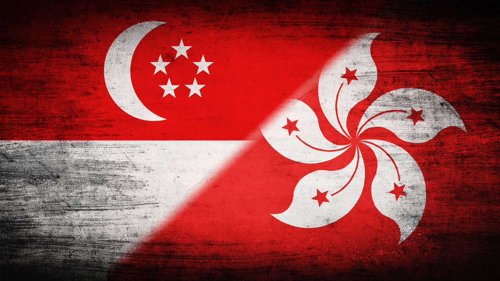 Flags of Hong Kong and Singapore, traditionally known as rival financial hubs in Asia. Shirinkin Yevgeny/Shutterstock