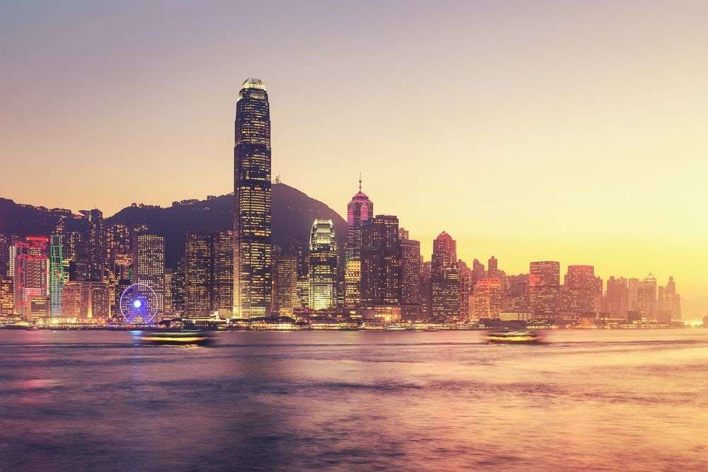 Victoria Harbour at twilight. Differr/Shutterstock