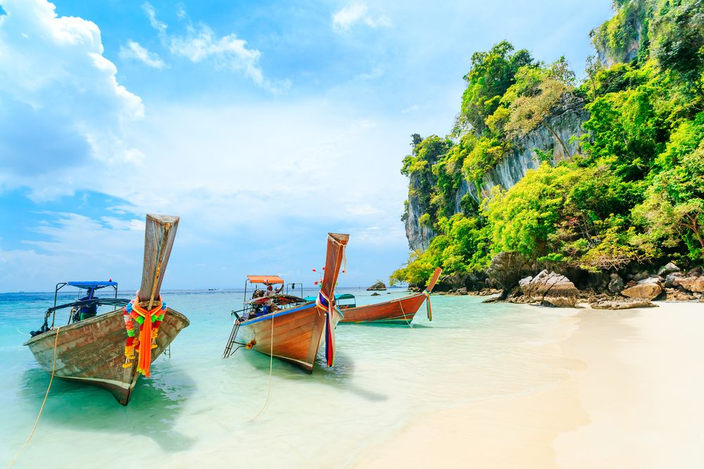 Long-tail boats at Phuket, still listed in many best-of lists for resort destinations. CHAINFOTO24/Shutterstock