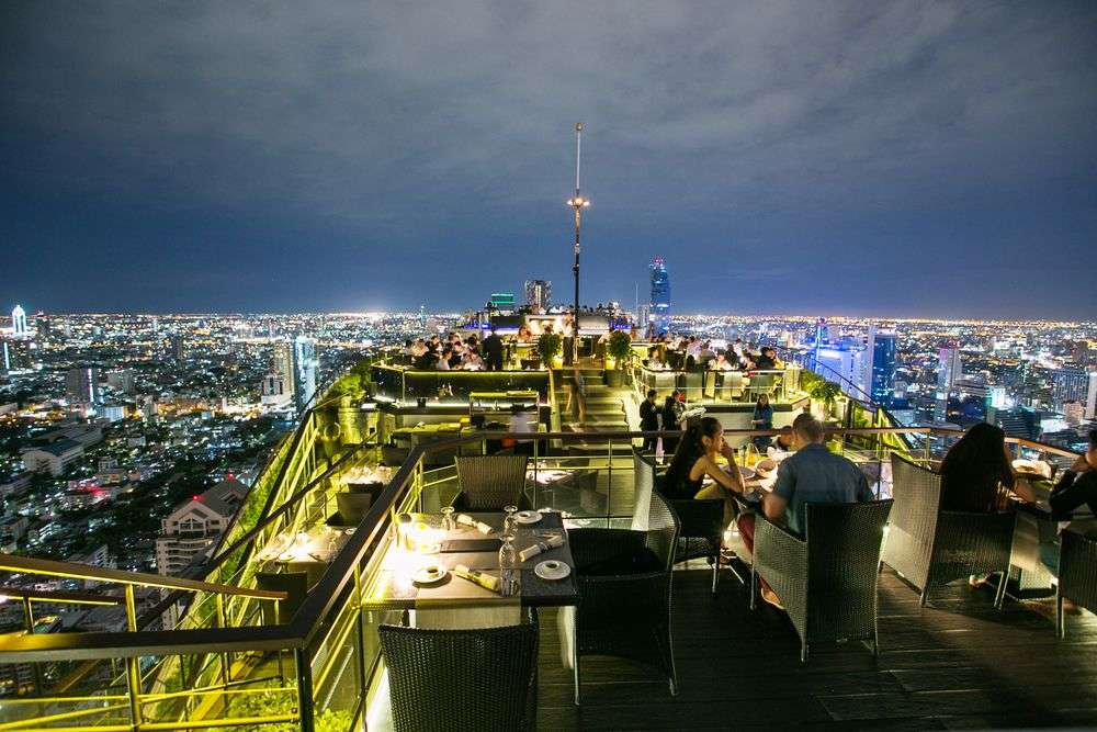 View from a rooftop restaurant and bar in Bangkok. Omongkol/Shutterstock