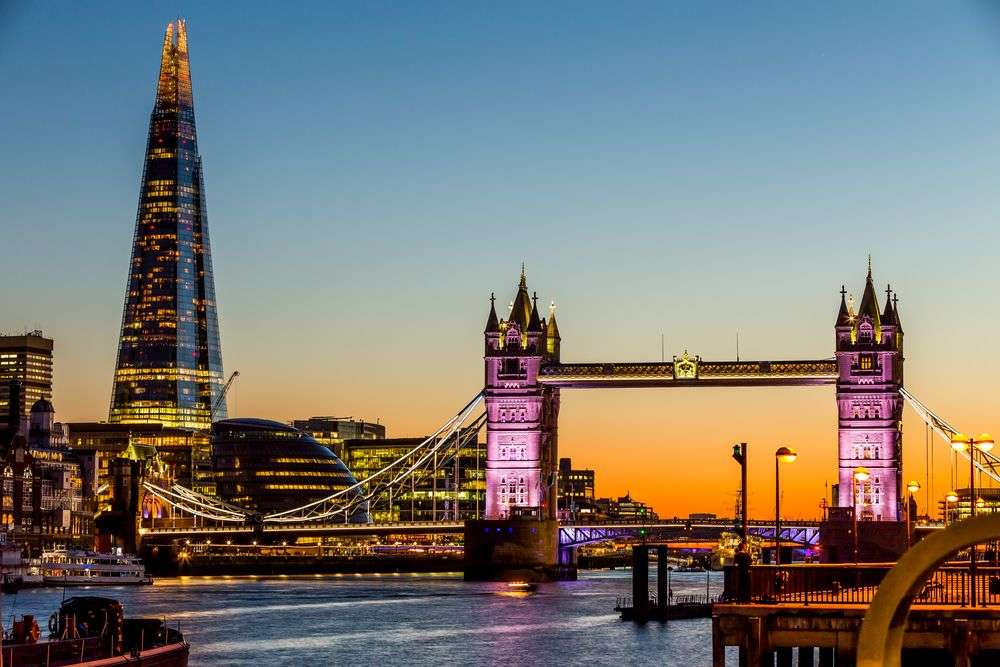The Shard in London, seen left of the iconic Tower Bridge, is the tallest building in the UK. maziarz/Shutterstock