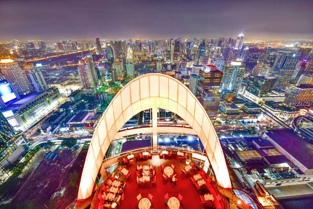 Night view from the Red Sky rooftop bar above Centara Grand at CentralWorld and Ratchaprasong intersection, Bangkok, Thailand. i viewfinder/Shutterstock
