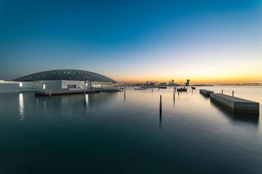 Sunset view from the Louvre Museum in Abu Dhabi, UAE. solkafa/Shutterstock