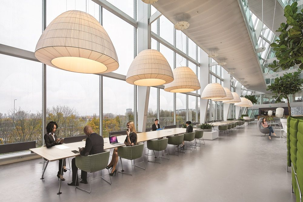 While The Edge performs the duties of a traditional office building, it also promotes interaction between colleagues through hot-desking and customisable workspaces